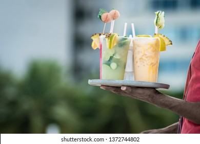 drinking caipirinha, caipifruta and othe tropical cocktails on Copacabana beach in Rio de Janeiro Brasil Vendors on Ipanema beach