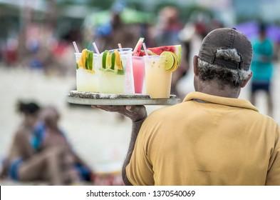drinking caipirinha and exotic cocktails on Copacabana beach in Rio de Janeiro Brasil