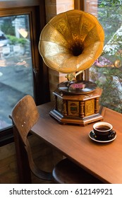 Drinking coffee and listen to the music from the vintage record player