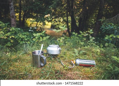 Drinking coffee in nature. Coffee is prepared on a gas burner.
