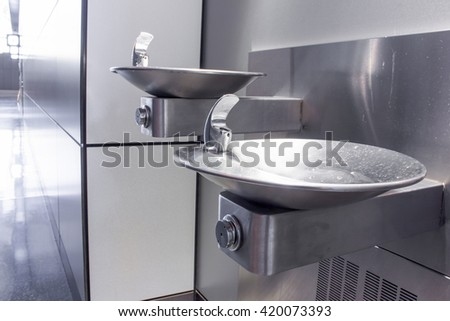 Drinking fountain in the departure lounge of the airport.