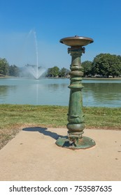 A drinking fountain on the shore and a water fountain in the cen