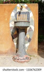 Drinking fountain in the yard of Saint Roma (Sant Romà) gothic church in Lloret de Mar, Spain.