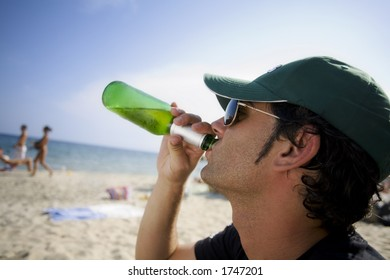 drinking a fresh, cold beer on a summer beach!!