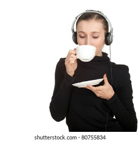 drinking girl in headphones keeping white cup of something hot