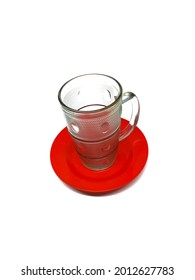 Drinking glasses and saucers. Transparent drinking glass on a saucer. This photo of drinking glasses and saucers is taken from the side. The background of the photo of drinking glasses and saucers is