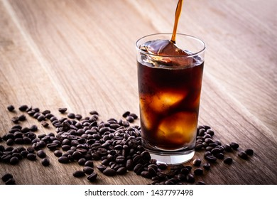 Drinking iced coffee at a cafe