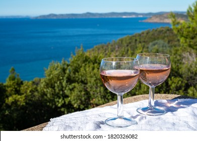 Drinking of local cold rose wine at sunset in summer with sail boats haven of Port grimaud on background, Provence, Var, France