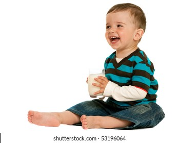 A drinking milk toddler is laughing; isolated on the white background