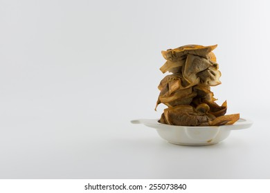 Drinking too much tea - stack of used teabags in stained tea bag holder with copy space