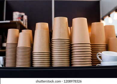 Lot of drinking paper coffee cups in piles. Stack of disposable coffee cup