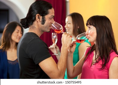 Drinking rose wine at a gathering with friends.