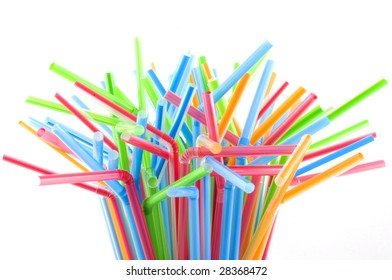Drinking straws in multiple colors, isolated on white.