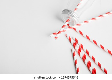 Drinking straws for party on white background]. Top view of colorful paper disposable eco-friendly straws for summer cocktails.