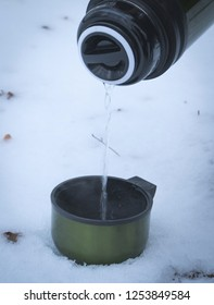 Drinking tea in the winter outdoors close up
