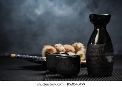 Drinking traditional sake and eating sushi.
