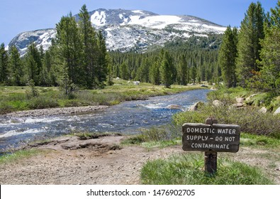 Drinking Water Conservation Sign: Visitors to Yosemite National Park are asked to protect the water supply from a mountain stream.