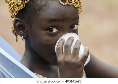 Drinking Water for Life - African Girl drinks water out of a cup