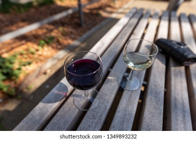 Drinking wine on a bench in the city for the Feast