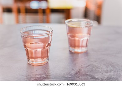 drinks and beverages, two glasses with non-alcoholic pink lemon lime bitter drink shot at shallow depth of field