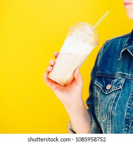 drinks, people and lifestyle concept - close up of woman drinking cold coffee with ice from plastic cup with straw at cafe