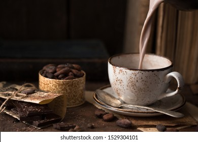 drinks and season concept - cup of hot chocolate. Pouring cacao