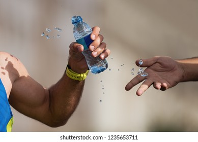 Drinks station at a running marathon,hydration drinking during a race