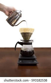 Drip brewing, filtered coffee, or pour-over is a method which involves pouring water over roasted, ground coffee beans contained in a filter isolated on white background