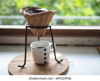 Drip Coffee Brewing in wooden earthen steamer