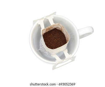 Drip coffee in cup (with clipping path) isolated on white background