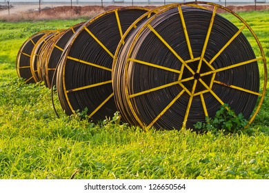 drip irrigation pipes waiting to be used in the field