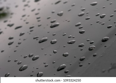driping water on the window car, raining drop on glass. blur vission