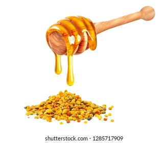 dripping honey and bee pollen isolated on white