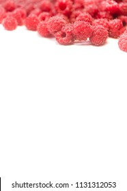 Dripping raspberry on white background. Close-up photo.