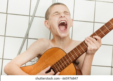Dripping wet loud male child singing and playing his guitar while in white tiled shower stall