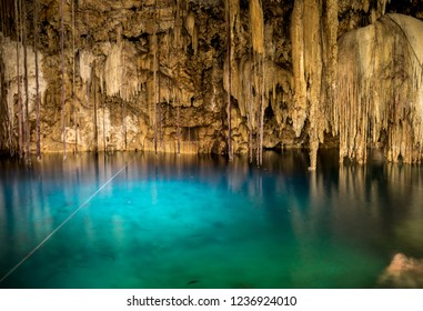 Dripstones in XKeken Cenote in Dzitnup near Valladolid, Yucatan, Mexico: Yucatans sinkholes feature crystal clear turquoise water and are connected by a network of underground rivers.