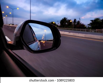 Drive a car Looking at the wing mirror at a distance For road safety