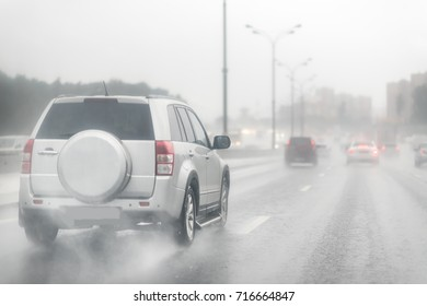 Drive car in rain on asphalt wet road. Clouds and sun
