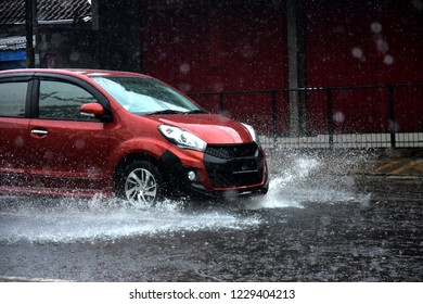 Drive during the rainy season Passing through puddles