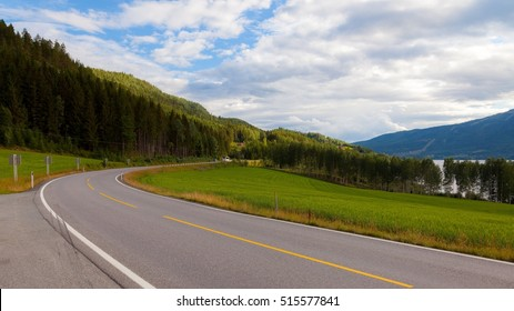 Drive highway road from Oslo to Bergen through beautiful mountain landscape with green grass and blue sky