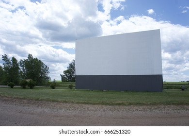 Drive in movie screen with clouds and trees (right justified)
