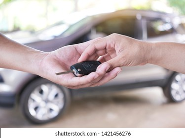 Drive safe. The woman hand gives the car key.