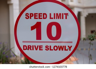 Drive Slowly - 10km/h - Red/white sign