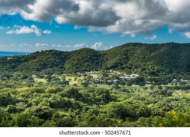 Drive through St. Croix along the seaside through the countryside.  Small village at the base of the hillside