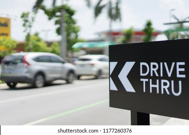 Drive thru sign with blur Car on background