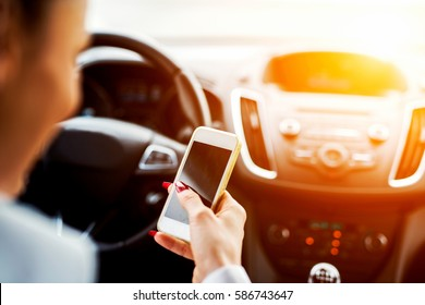 Drive typing female. Smart phone accident distract driving car.