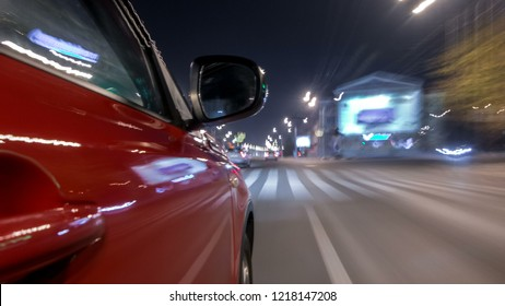 Drivelapse urban look from fast driving car at a night avenue in a city timelapse hyperlapse, road with lights reflected on car at high speed. Rapid rhythm of a modern city.