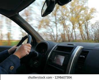 The driver attitude with hands on the steering wheel in car on high speed