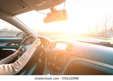 Driver car. Fun drive in winter vacation ride day. Happy young woman have road travel trip inside car in sunny day