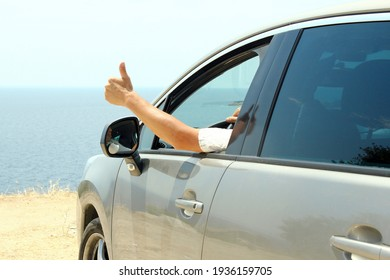 driver in car at sea in summer